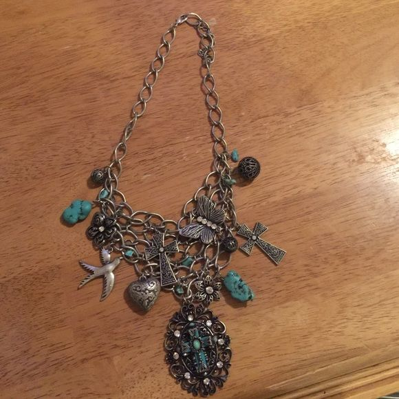 Turquoise and Silver Necklace Charm necklace that will get you lots of looks, stunning on! A must for the upcoming rodeo season Jewelry Necklaces