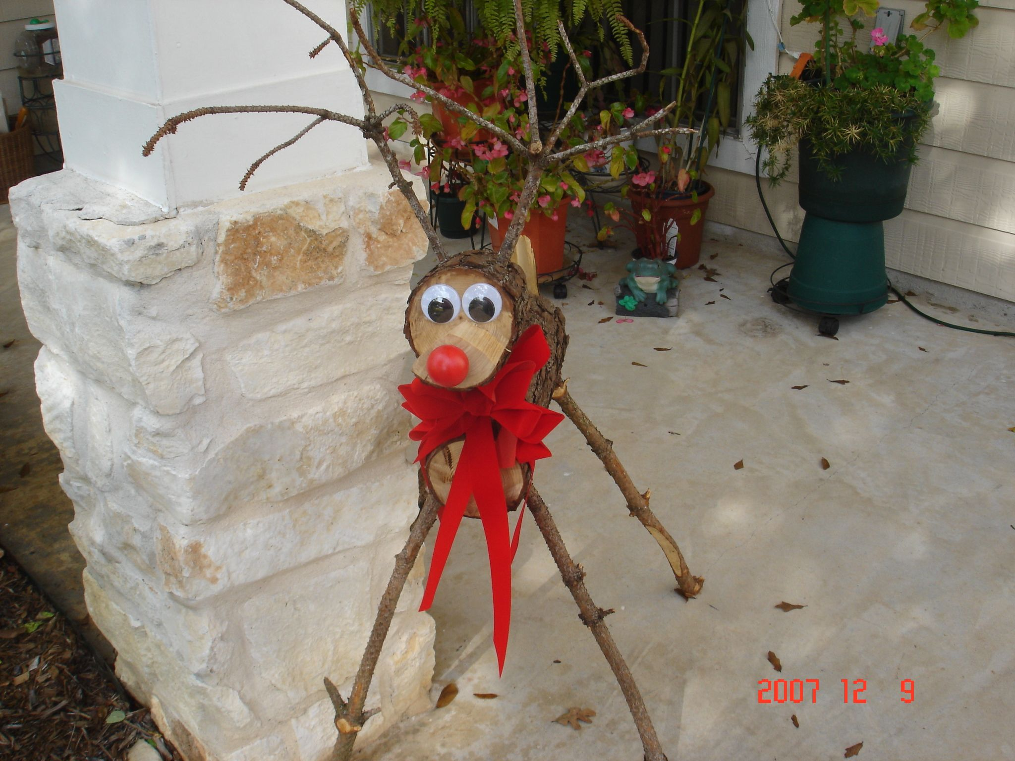christmas reindeer made from log and limbs for the home