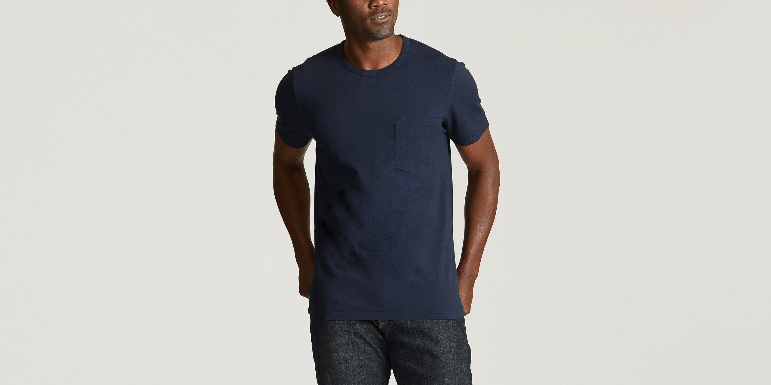 "Made from a stretch-pique knit, the Pique Pocket Tee is the basic every man needs. It features a slim fit and a chest patch pocket with a subtle notch detail, as well as a split hem at the side seams. The Pique Pocket Tee raises the bar on the everyday tee. Size & fit Fits true to size. In-studio model is 6'0"" and wearing size medium. View Size Guide Technical specs 95% cotton, 5% elastane Stretch-pique knit fabric Self binding at neck with double-needle topstitch Chest patch pocket with notch d"