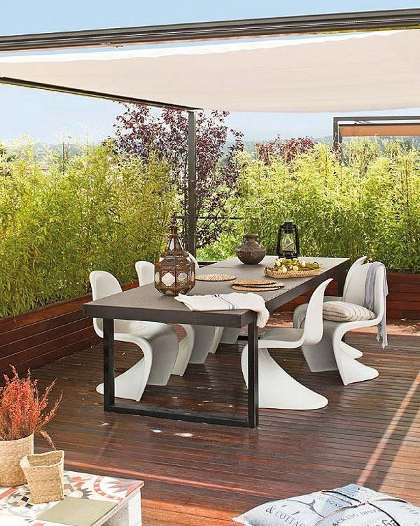 Comedor exterior con sillas Panton www.barefootstyling.com | Hanging ...
