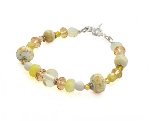 This beautiful and elegant yellow glass bead bracelet has been handmade with…
