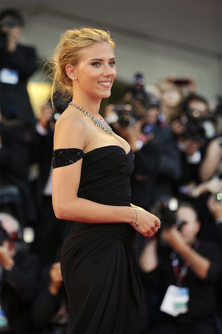 Actress Scarlett Johansson poses for photographers on the red carpet for the screening of the film Under The Skin at the 70th edition of the Venice Film Festival held from Aug. 28 through Sept. 7, in Venice, Italy, Tuesday, Sept. 3, 2013. (AP Photo/Andrew Medichini)
