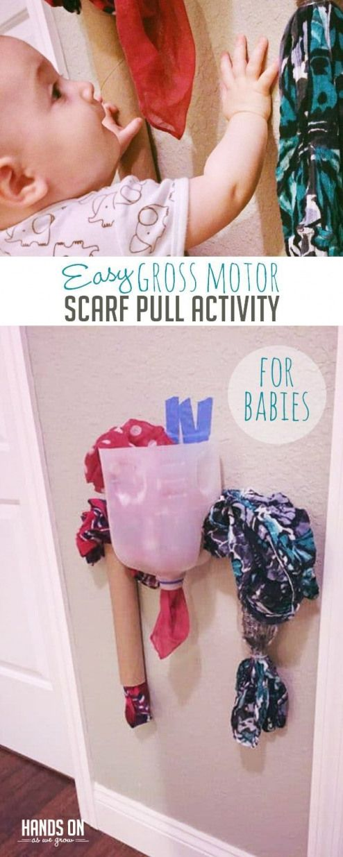 Use a simple scarf pull activity to work on gross motor skills and help your baby work on standing too via handsonaswegrow