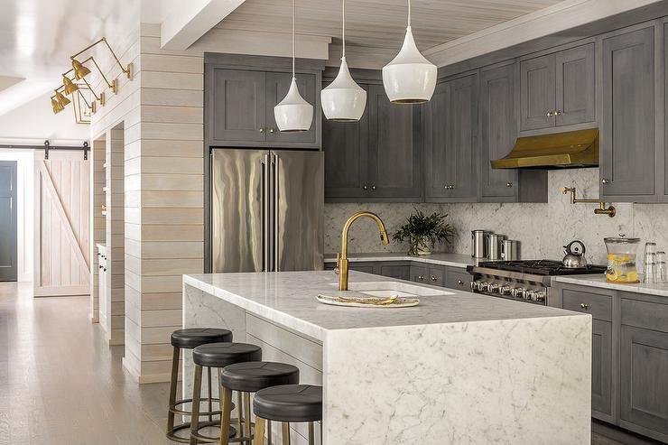 Beautifully Appointed Kitchen Showcases A Stunning Shiplap Island Finished With A Carrera Marble Waterfall Counter Kitchen Design Home Kitchens Kitchen Remodel