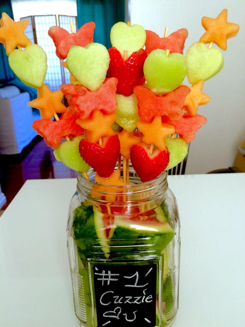 diy edible arrangement in medium sized mason jar with chalk board