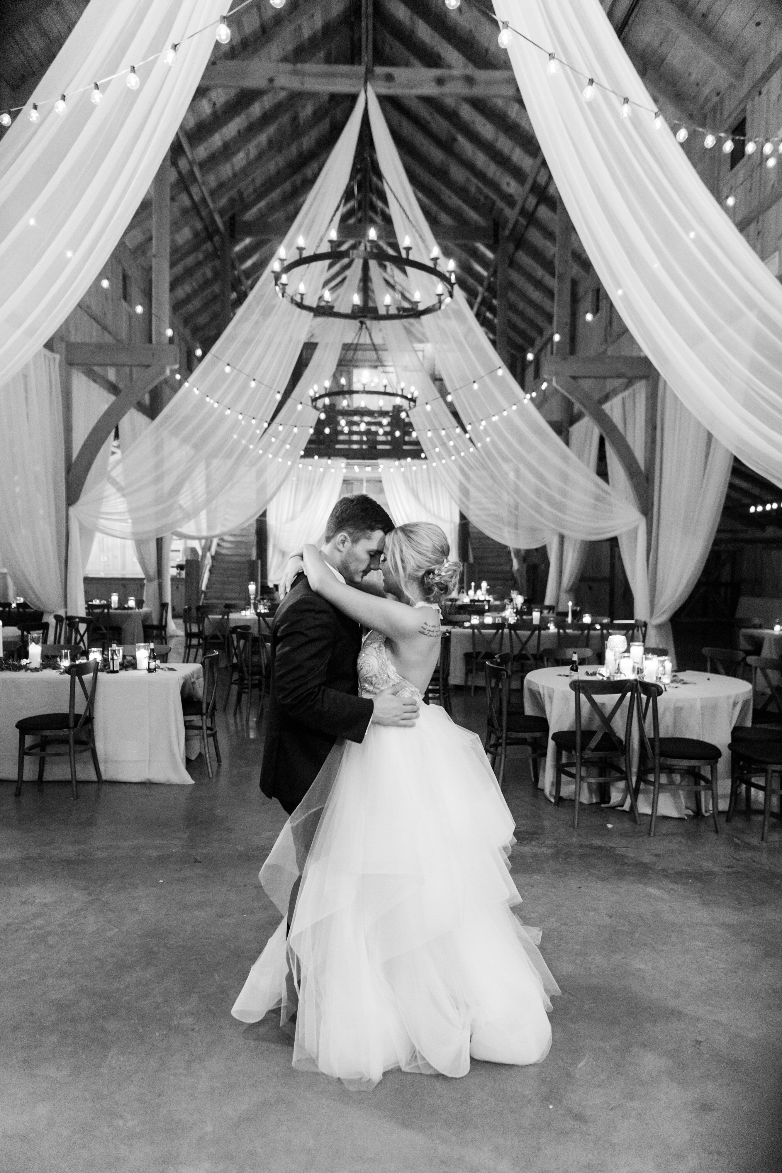 Black And White Wedding Photo Of Bride And Groom At The Venue At