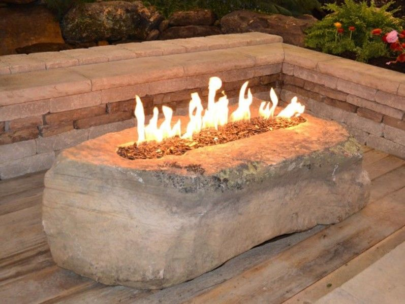 Gas fire pit in a boulder lit and ready to entertain ...