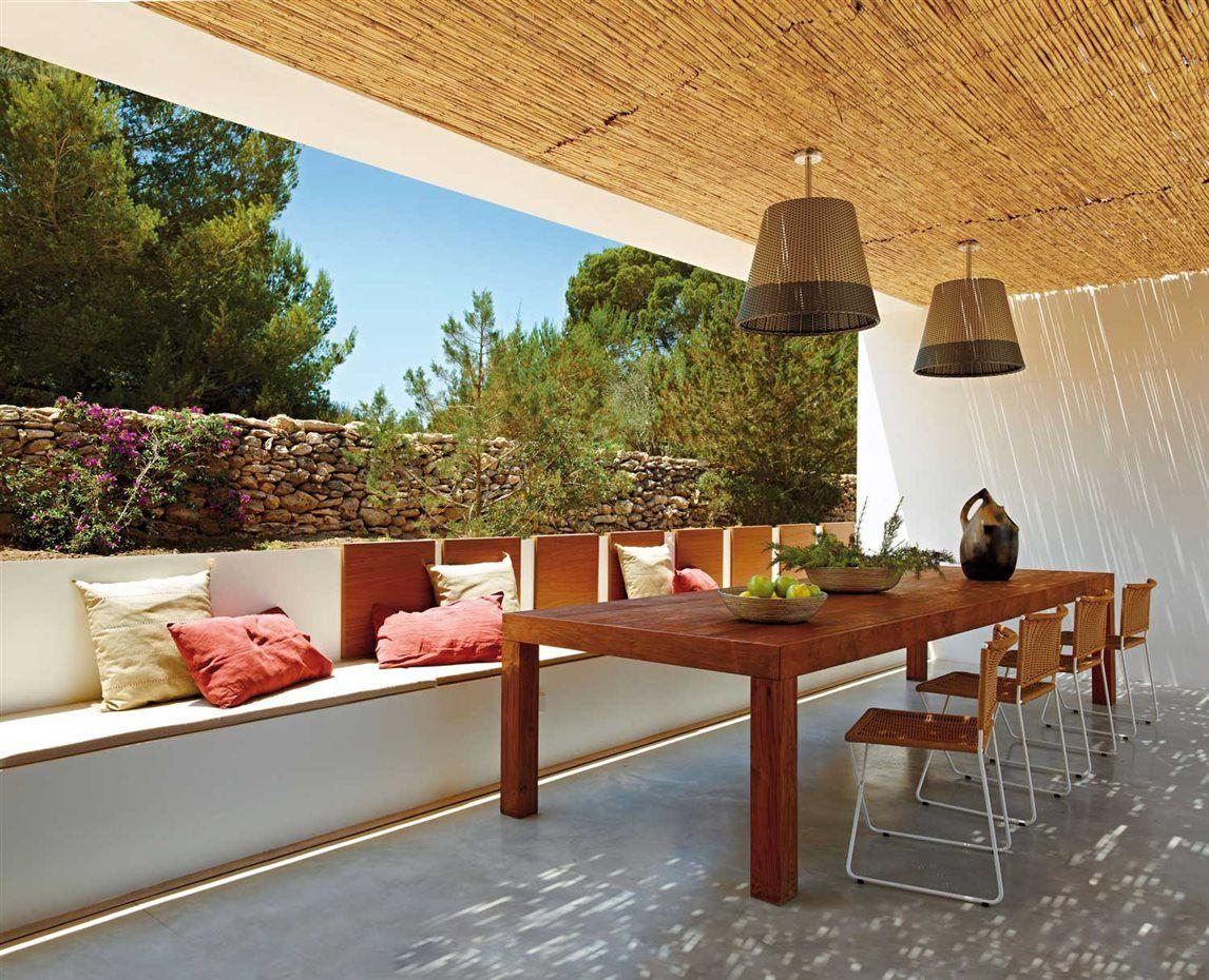 en el porche mesa diseada por estudio mari castell y realizada en madera de iroco por comoda sillas ramn de ramn bigas para santa cole - Bigas De Madera