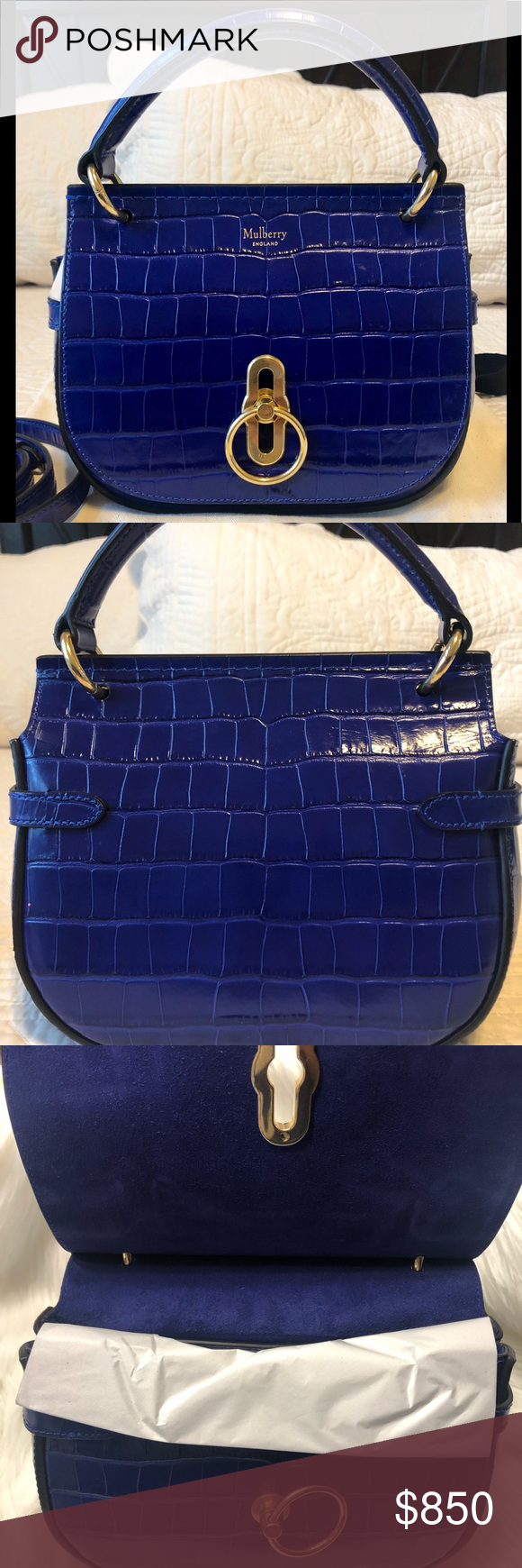 Mulberry Small Amberley Satchel This beautiful cobalt blue, croc print satchel was purchased for my daughter. The bag was too small for her needs and went unused. The bag converts from satchel to crossbody. The bag is in new condition,...please see last pic for details. Comes with tag, care book and dust bag. Mulberry Bags Crossbody Bags #mulberrybag Mulberry Small Amberley Satchel This beautiful cobalt blue, croc print satchel was purchased for my daughter. The bag was too small for her needs a #mulberrybag