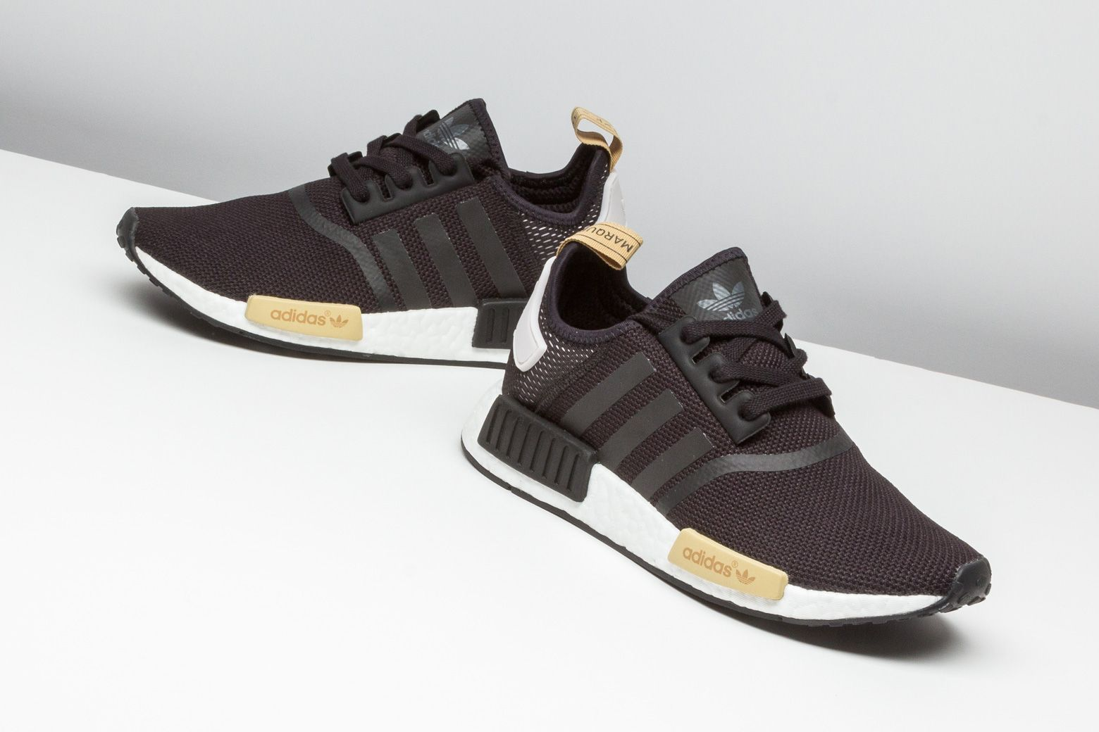 1ecfad8d75495 adidas delivered this clean NMD R1 for women who love the popular  silhouette. http