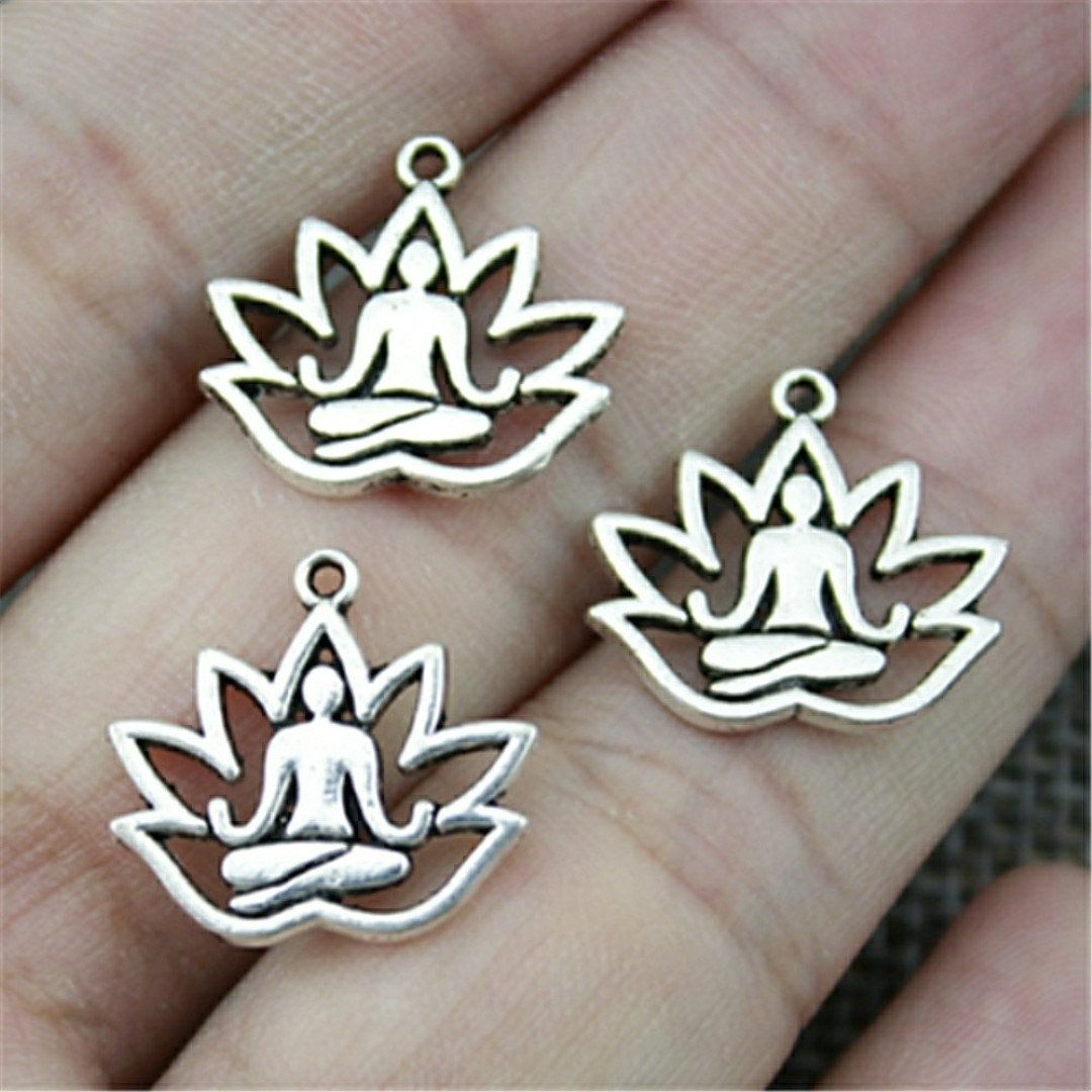 Hand made silver metal charms pack of 20