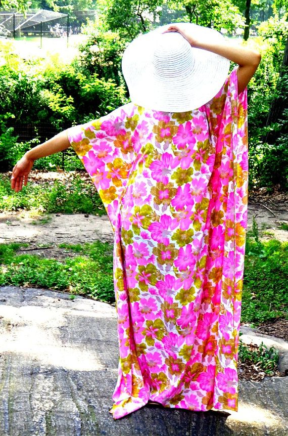 This Kaftan is a one of a kind outfit to wear on your next vacation or on a fun summer day out. It is Medium size (for size 14 women).  Opaque textured fabric, perfect to wear as a lose fitting, flowy day dress in hot weather. Dress is full length, maxi-style.  Color: Lilac and Olive green floral pattern.  This kaftan comes in a Large.