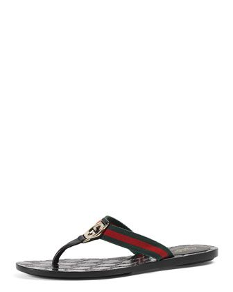 2589276caab4 Gucci sandal with green red green signature web and black leather trim.  Light golden hardware. Microguccisima rubber sole. Made in Italy.