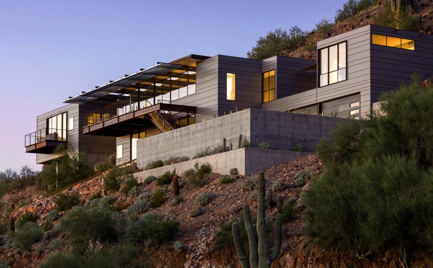 Concrete glass and steel structure hovers above arizona desert