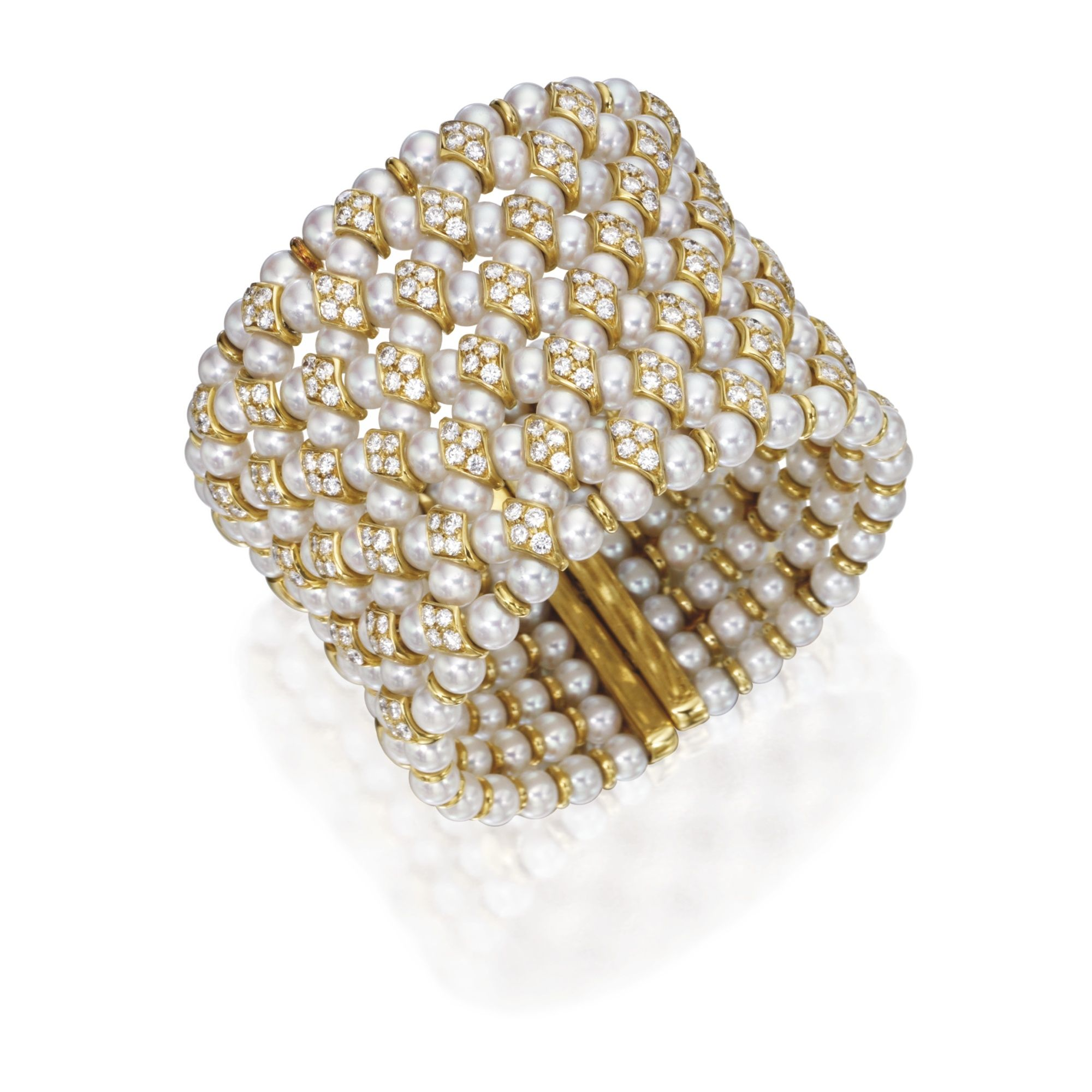 18 KARAT GOLD, DIAMOND AND CULTURED PEARL CUFF BRACELET Composed of nine rows of cultured pearls measuring approximately 6.0 to 5.5 mm., set throughout with round diamonds weighing approximately 8.30 carats