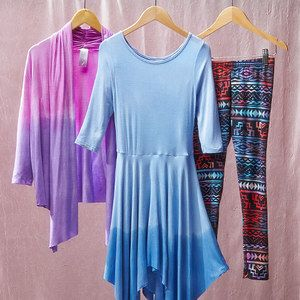 Get a hue with this colorful collection of cardigans, leggings and dresses. Made with butter-soft fabrics like rayon and sewn with a bit of stretch, they're sure to get as much wear for their makeup as their look. Pretty patterns and edgy effects offer artsy girls a different way to dress every day.