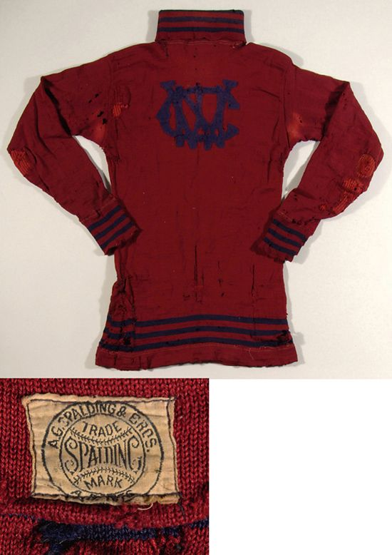 "Early Spalding football jersey c.1890-1900. Maroon pull over turtleneck jersey has unknown team logo applied to front and ""Spalding"" manufacturer's tag in tail. $770"