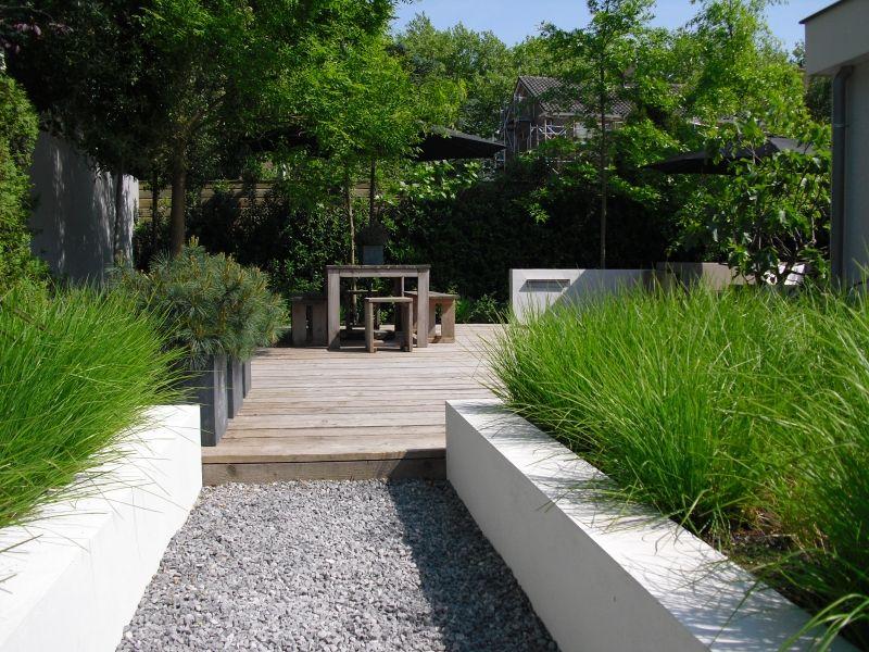 Moderne tuin vijver hovenier hoofddorp tuin pinterest gardens grasses and garden ideas - Landscaping modern huis ...