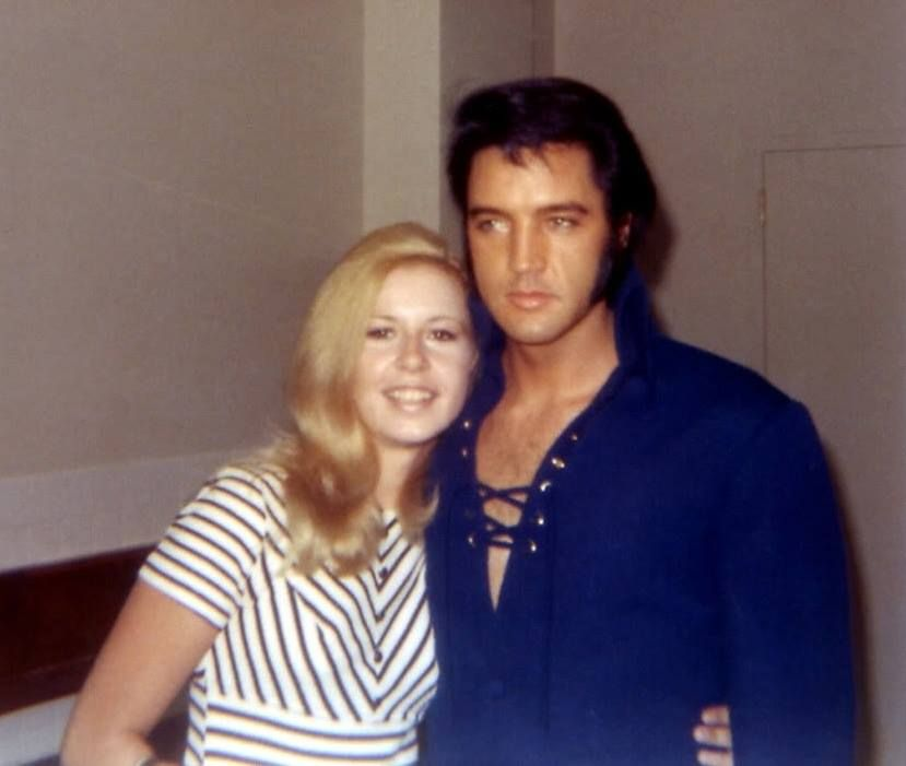 One lucky fan with Elvis backstage Aug. 1970
