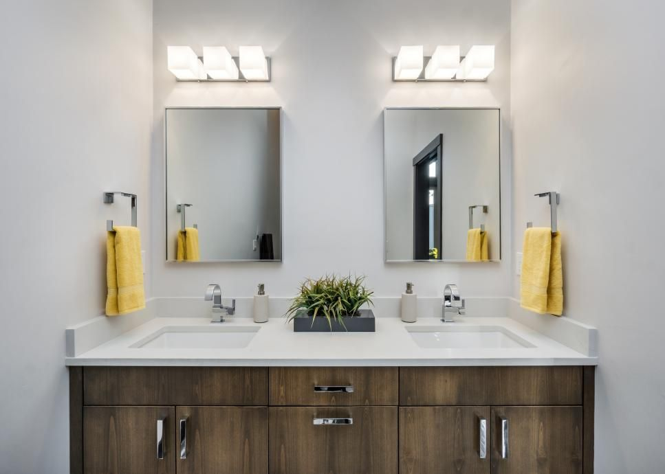 A Custom, Wood Vanity Brings A Soft, Rustic Touch To This Bright White,  Modern Master Bathroom. Bold Yellow Hand Towels Add A Lovely Pop Of Color.