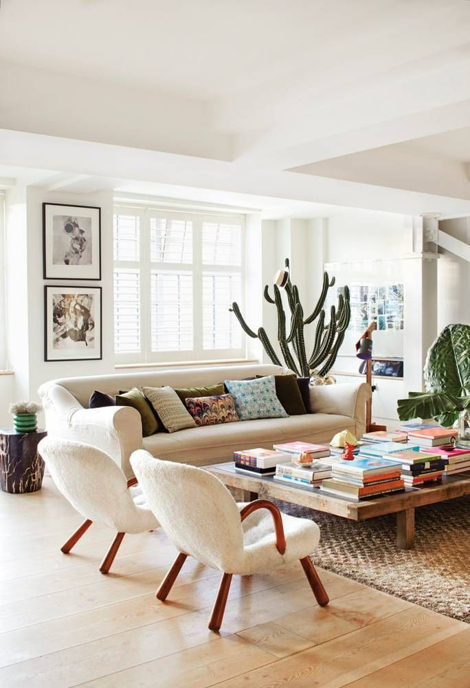 Boho Modern Decor Living Room With Cactus, White Couch, Retro Inspired Arm  Chairs And Low Wood Coffee Table
