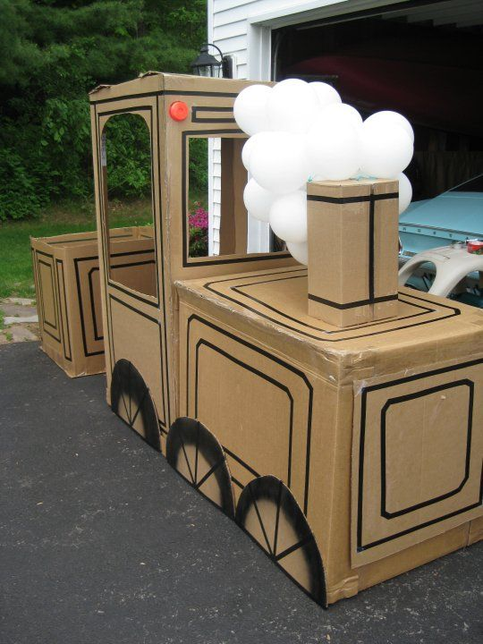 Cardboard box train I made for my son's 2nd birthday.  Great for photos at party!