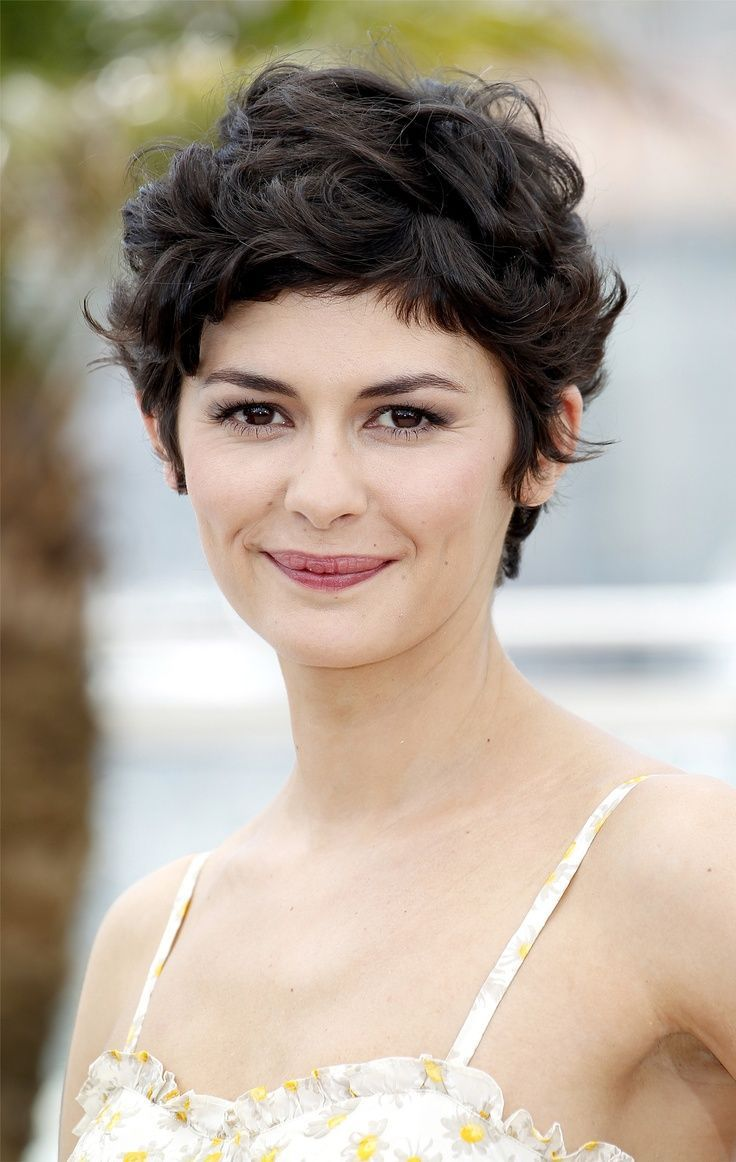 audrey tautou short haircut: very closely chopped brunette curly