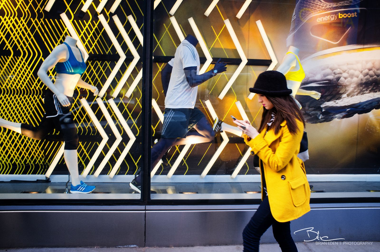 https://flic.kr/p/e6AEs8   Against the grain   I love the color coordination between the girl's outfit and the window display. The focus isn't great, but I'm lucky to have even gotten the shot off. Just barely snagged this one. The Adidas store on Houston and Broadway in Soho, New York www.brianedenphotography.com www.facebook.com/BrianEdenPhotography