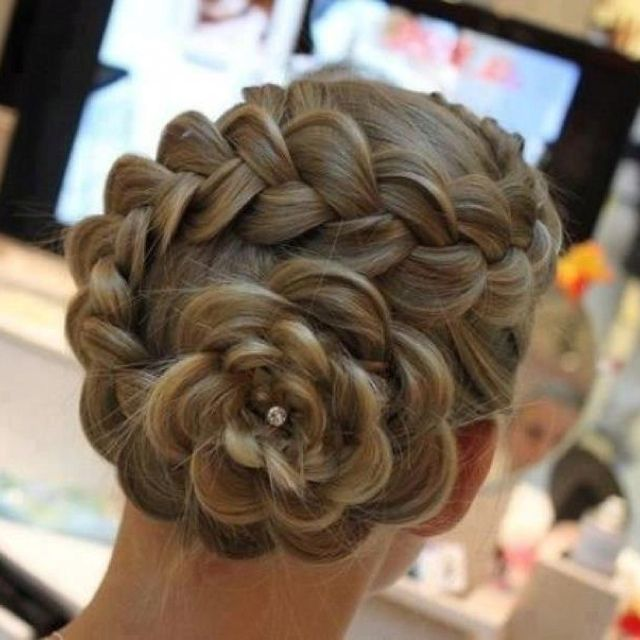 A flower braid.  Isn't that awesome? I think I want to use that hairstyle for several of my bridesmaids sometime in the future.