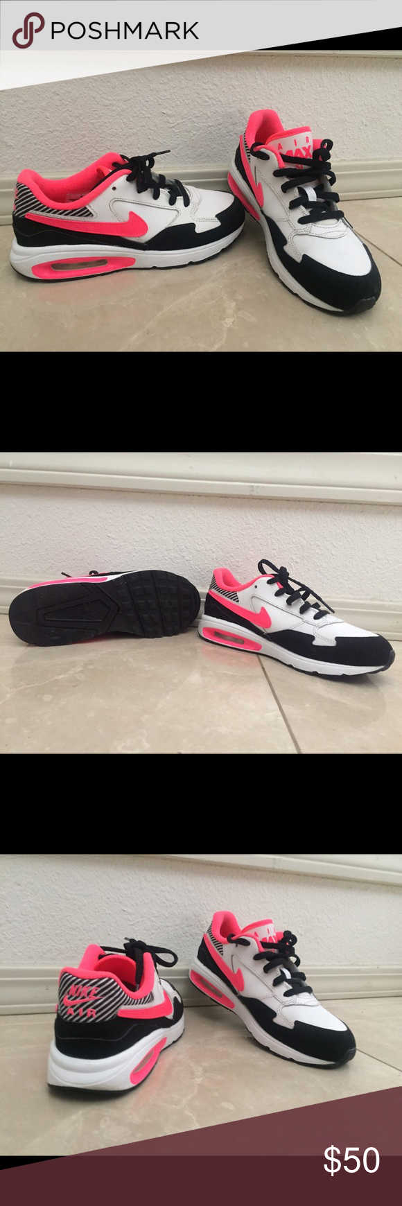 Nikes Sneakers ( youth) Black and white Nikes great condition like new worn 3 times. Nike Shoes Sneakers