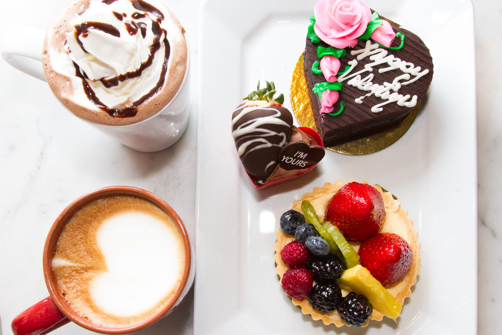 Valentine's Day! Drinks for two at our coffee bar, fresh fruit tart, valentine mousse heart cup, and chocolate cake!