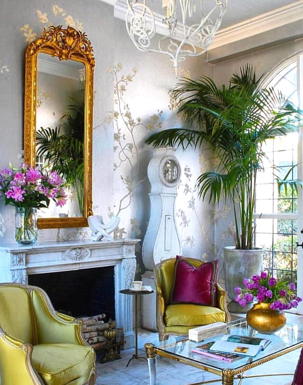 Whimsical Living Room With A Beautiful Silver Floral Wallpaper The Two Chairs French Provincial Decor Living Room Floral Chair Living Room Vibrant Living Room Whimsical living room decor