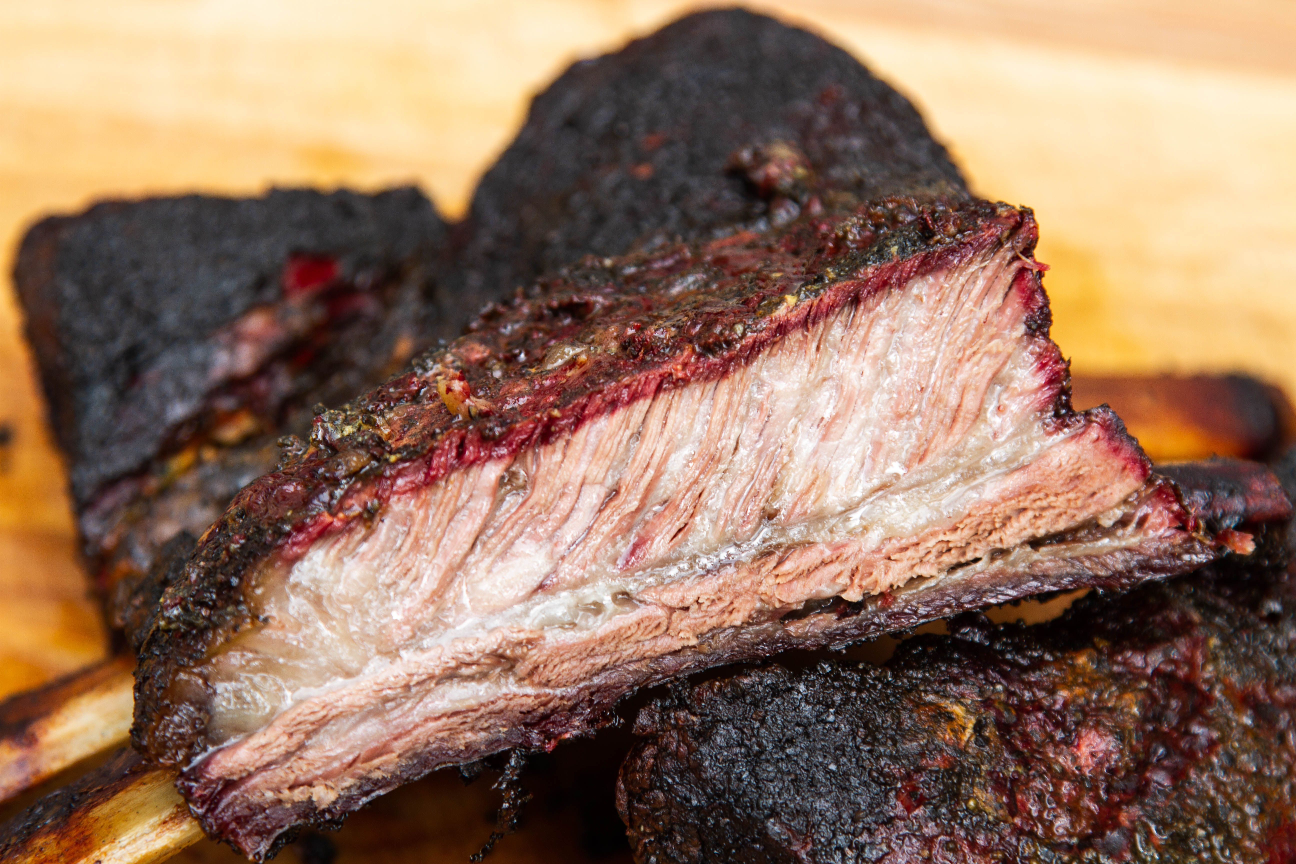 Smoked Beef Dino Ribs Learn To Smoke Meat With Jeff Phillips Recipe Smoked Food Recipes Smoked Beef Rib Recipes