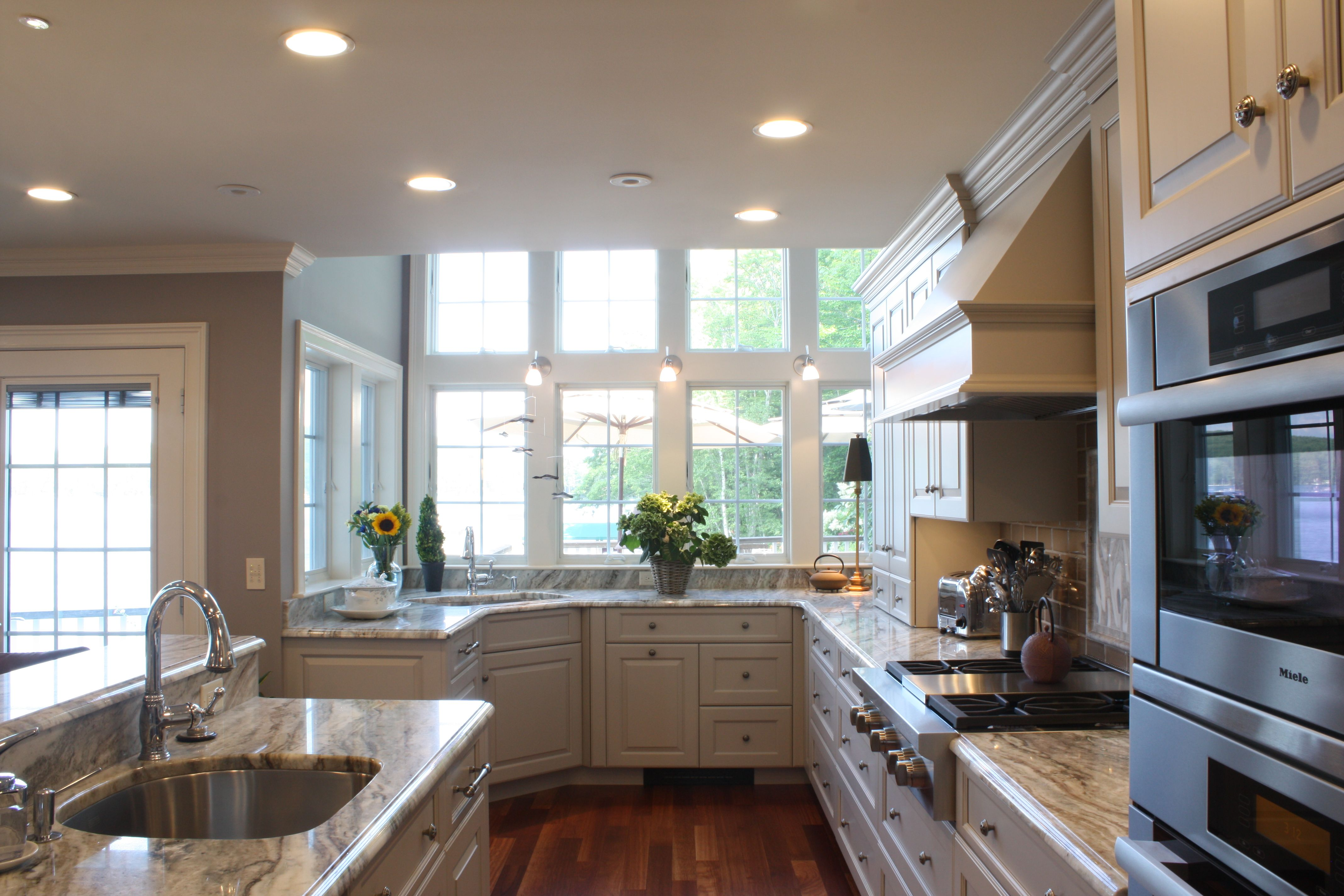 White cabinet Kitchen- corner sink, prep island with sink ...