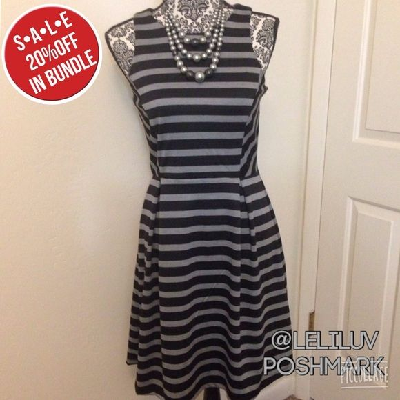"Fit flare striped dress gray black day 2 night! NWT, box pleat fit and flare dress. Stretchy, comfortable, perfect day-to-night dress! Striped in black and gray. Back zipper goes from back of neck to a couple inches below the waist. Approx. measurements: armpit to armpit: 15""- 15 1/2"" (laying flat), waist 13 1/2"", shoulder to waist seam: 16"", waist seam to hem: 21"". Made of 96% polyester, 4% spandex, machine wash cold. Necklace not included. NO TRADES, NO PAYPAL. Apt. 9 Dresses Midi"