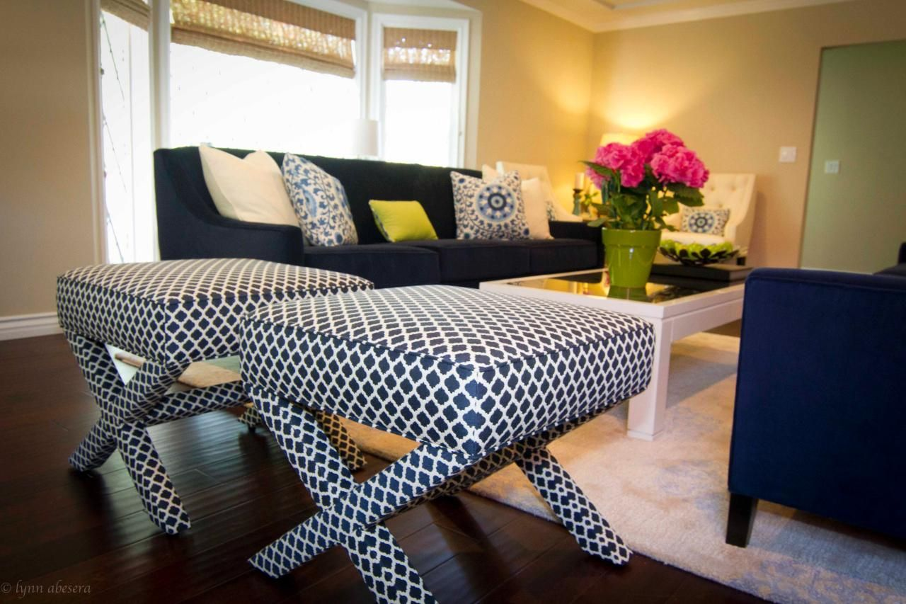 A Pair Of Upholstered Stools Offers Versatile Seating In This Transitional Living  Room. Bright And