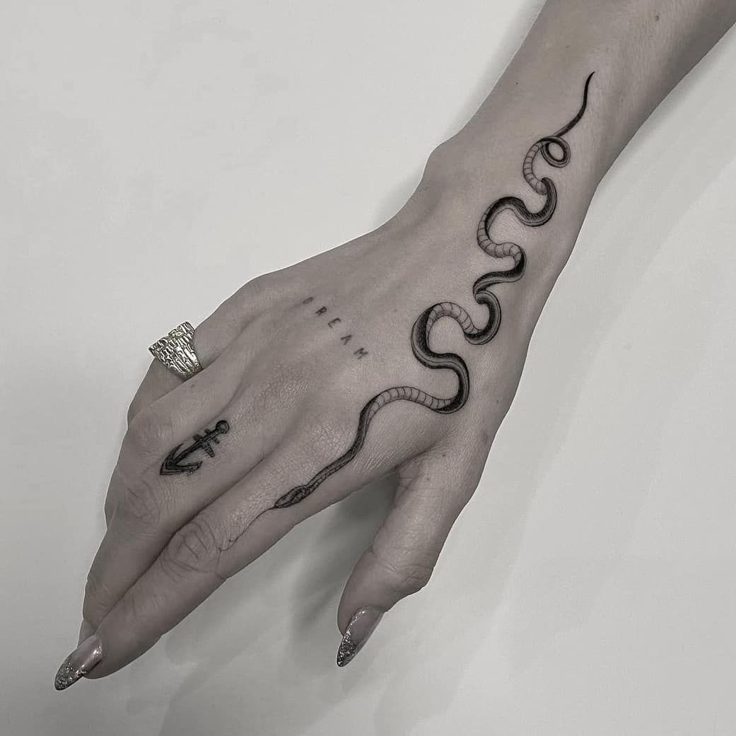 12+ Awesome Snake wrapped around shoulder tattoo ideas