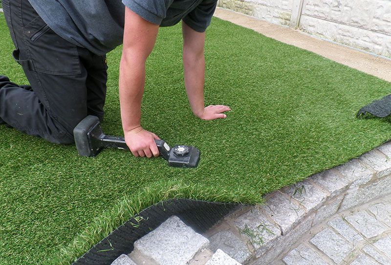 Laying Artificial Turf On Concrete Pavers Is A Simple Yet Effective Way To Give Artificial Grass Installation Best Artificial Grass Installing Artificial Turf