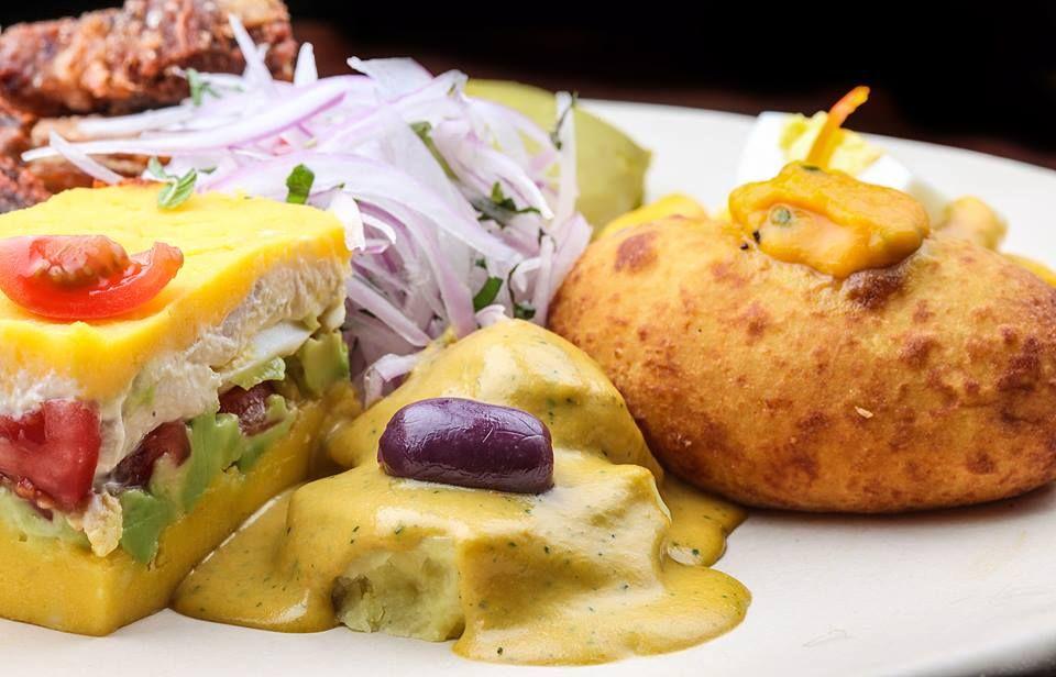 Causa limeña, papas rellenas y papas con salsa de ají amarillo