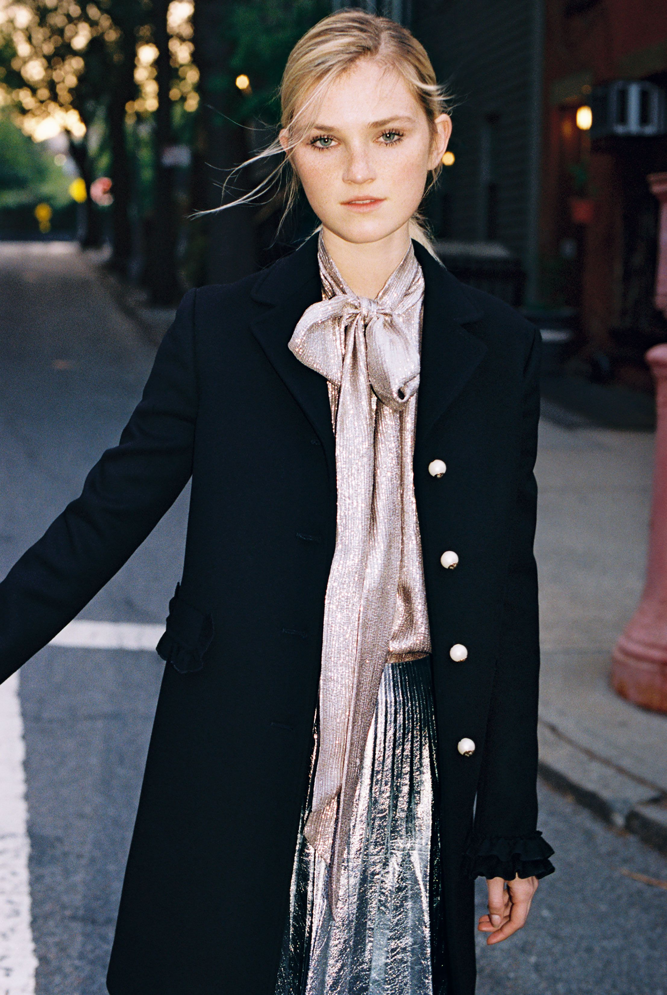 160cb84627a98 Alexa Reynen, 18, in a Gucci coat with GG pearl buttons, vintage shirt, and  Gucci metallic leather skirt.