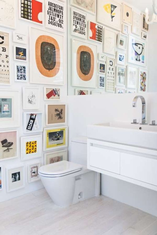 Lovely White Bathroom Decorated Frames   Home Decorating Trends   Homedit