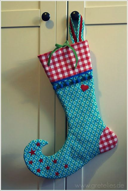 I adore this stocking shape!! I looks elf-like, don\'t you think so ...