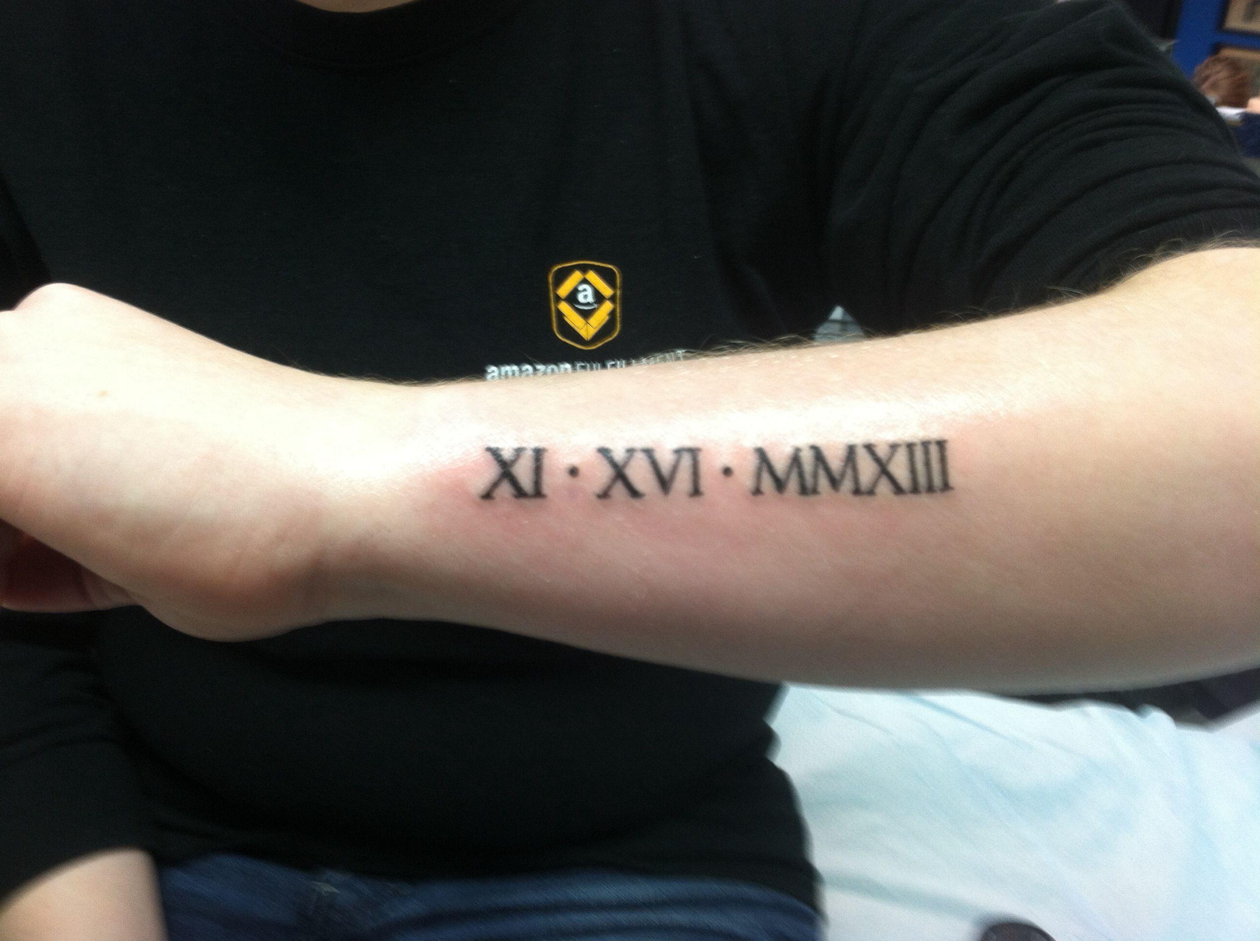 Roman numerals tattoo of Ian's birthday on my arm. Roman