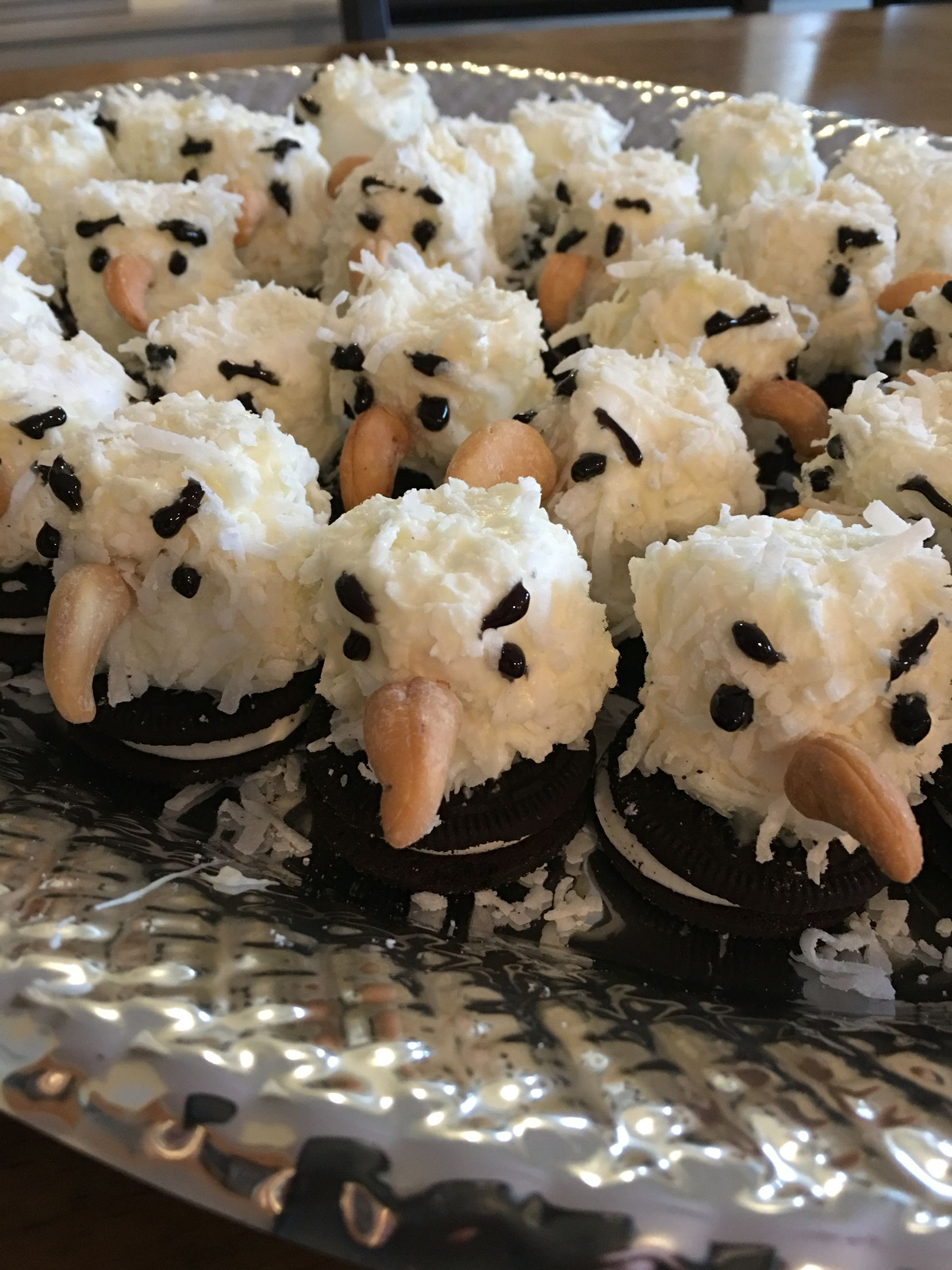 Eagles: marshmallows covered in melted white chocolate- rolled in coconut and placed on Oreo to dry. Cashew beak and black eyes.