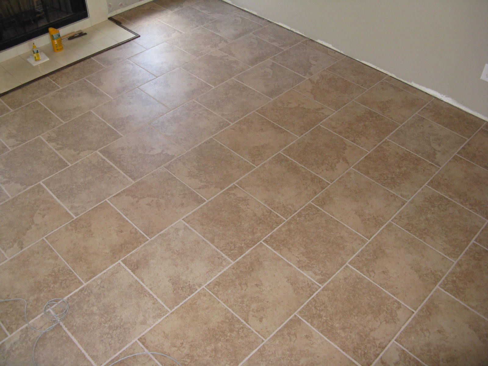 Porcelain tile patterns ceramic tile work design for Tile patterns for kitchen floor