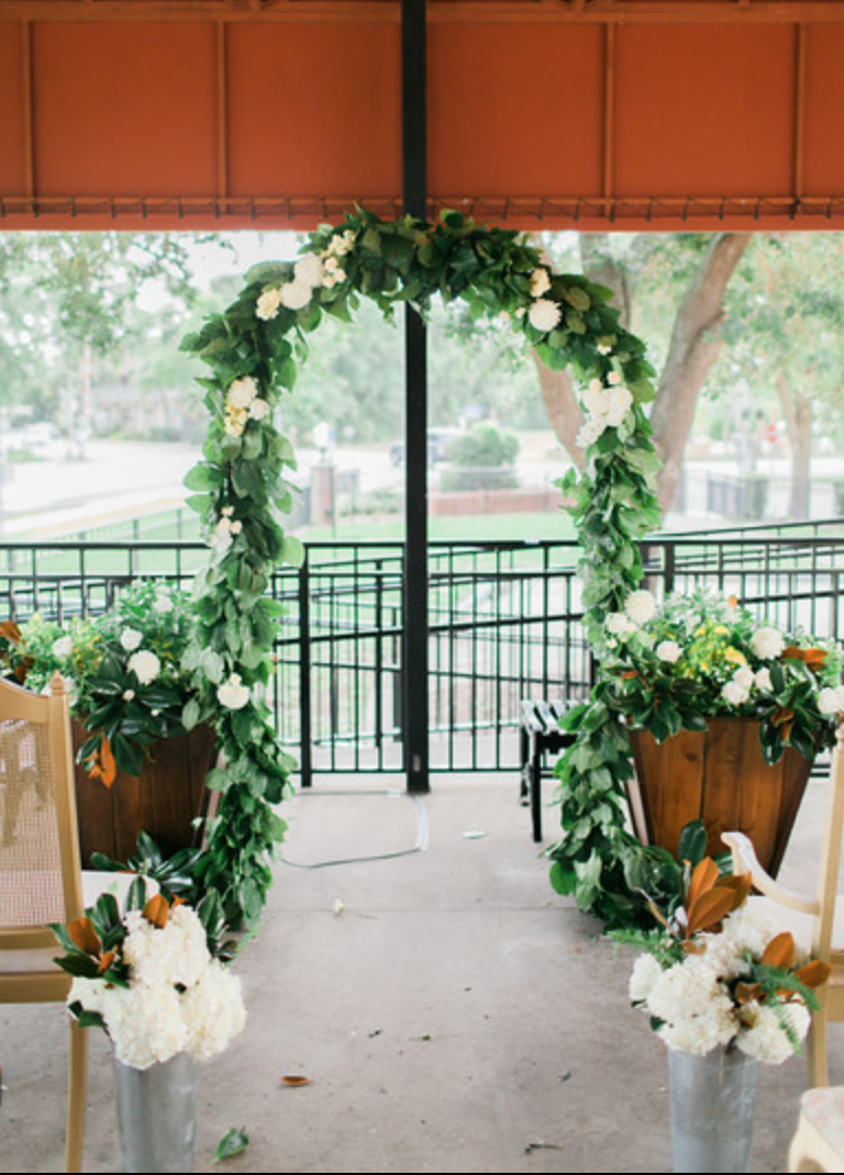 Outdoor Ceremony At The Winter Park Farmers Market Highlighted By A Wedding Arch Of Lush Lemon Leaf With C Outdoor Ceremony Farmers Market Wedding Wedding Arch