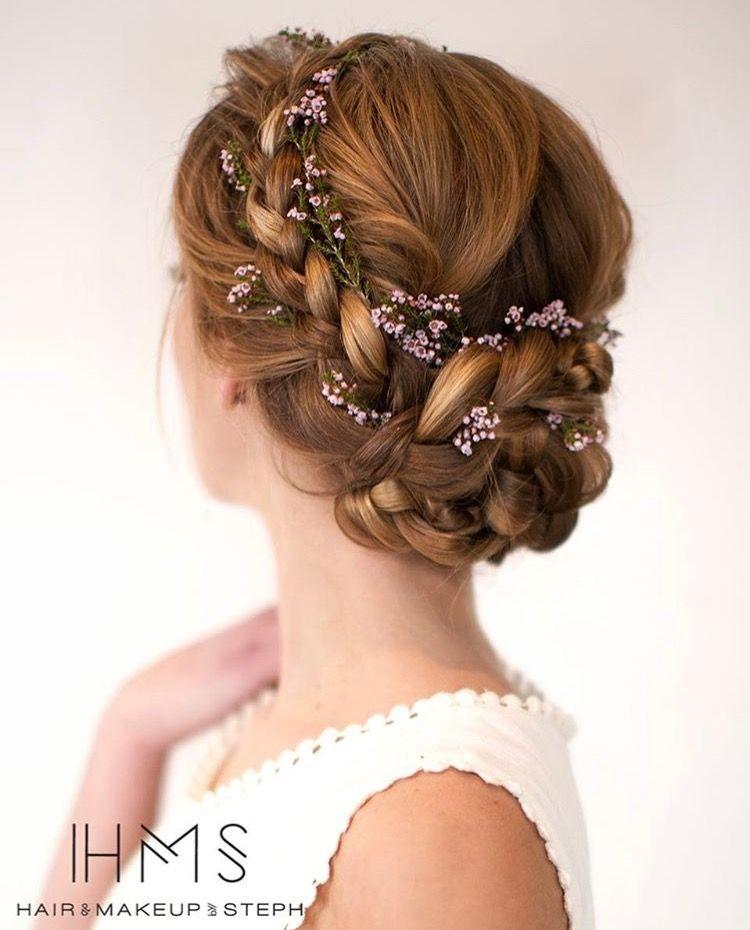 Low Braided Flower Adorned Bun Wedding Hairstyles For Long Hair Flower Crown Hairstyle Medium Hair Styles