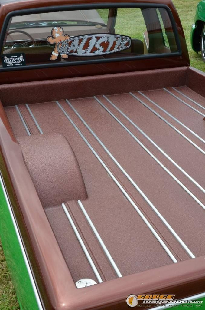 Custom bed floor with what appears to be a color matched for Wood floor kits for pickups