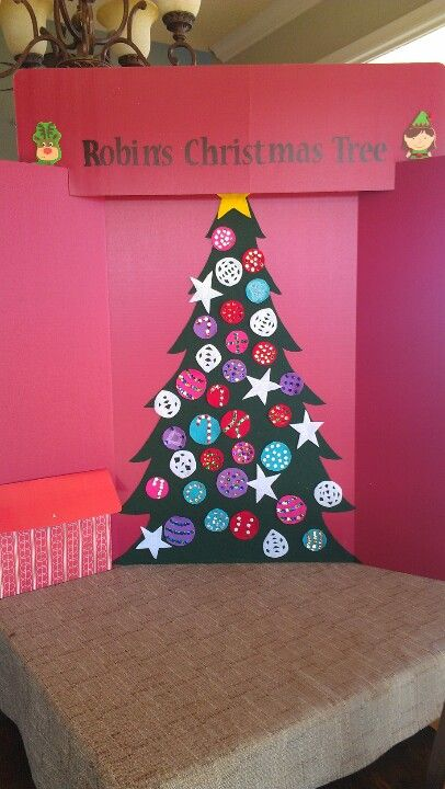 "Felt Christmas tree on a 3 foot tri-fold board with an expanding file folder ""present"" to store the ornaments."