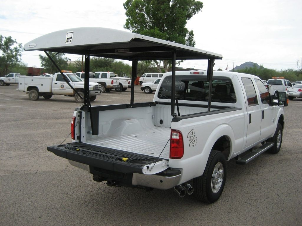 Truck Bed Tops Fully raised and locked position Pickup